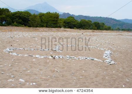 Heart Shaped Pebbles On The Beach