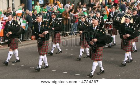 Irishmens In Them Kilst Are Playing On Bagpipe During The St. Patrick's Day Parade 2009