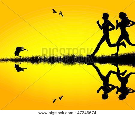 Silhouette of a couple jogging