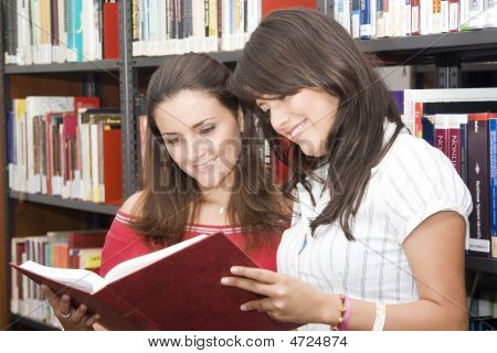 Two Students Comparting At The Library