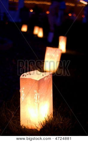 Border of Luminary Bags at Night lining walkway. poster