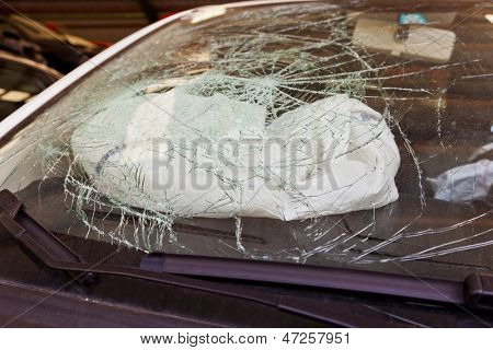 a broken windshield in an accident, a car airbag
