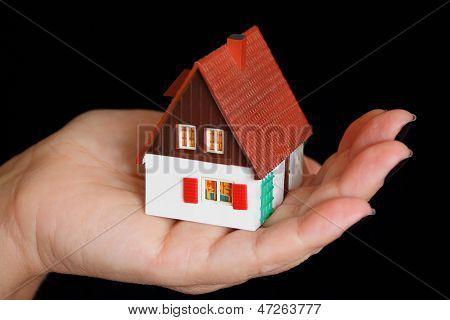 Dollhouse In Human Hand
