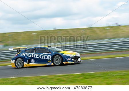 MOSCOW - JUNE 23: Jeroen Schothorst of TDS Racing team race at Megane Trophy V6 race at World Series by Renault in Moscow Raceway on June 23, 2013 in Moscow