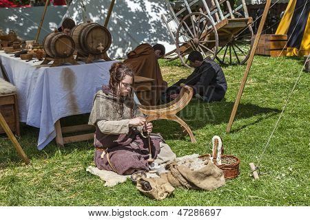 Medieval Young Woman Spinning Wool