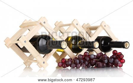 Bottles of wine placed on wooden stand isolated on white