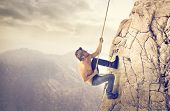 brave young man climbs a mountain poster