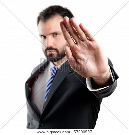Young Businessman Doing Stop Sign Over White Background