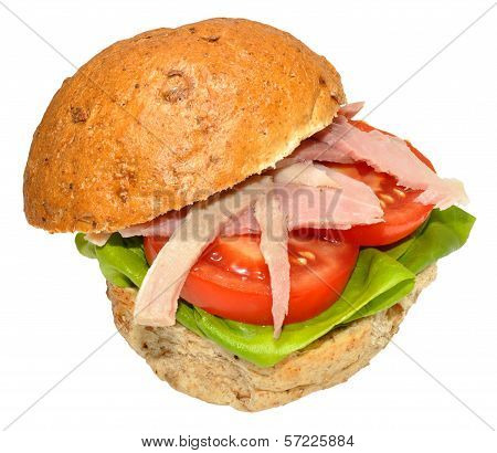 Ham sandwich on a granary bread roll with tomato and lettuce, isolated on a white background. poster