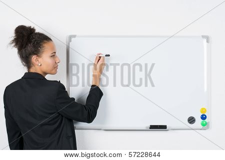 Young Business Woman Writes At Board