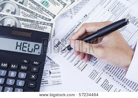 Accountant Filling The Tax Forms