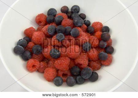 Delicious Blueberry And Raspberry Desset In Plain White Bowl.