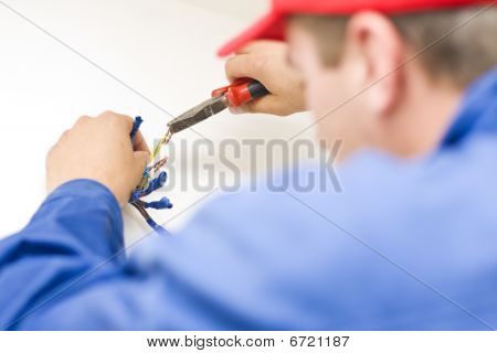 Handyman Working With Wires