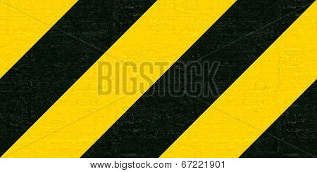 Warning black and yellow hazard stripes texture. Construction sign