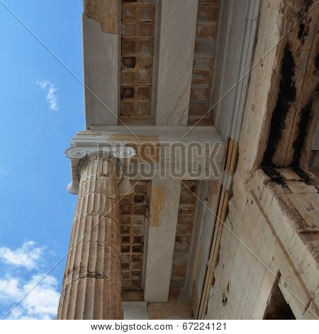 Ionic column and marble ceiling ancient architecture detail. Acropolis Propylea Athens Greece. poster