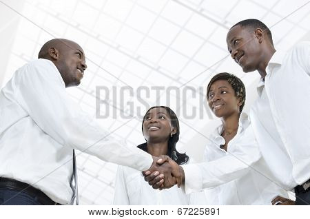 Four African Business Partners Shake Hands