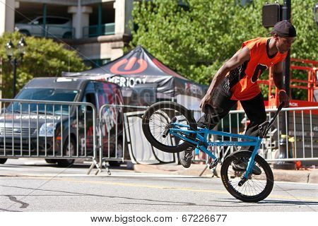 Man Practices Flatland Bmx Tricks Before Competition