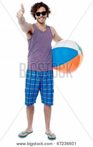 Cheerful Guy Giving Thumbs Up Gesture
