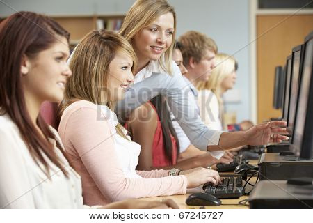 Students working on computers in library