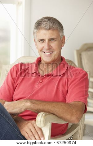 Mid age man at home