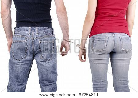 Man and woman hands in handcuffs.