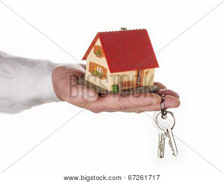 Hand With House And Key