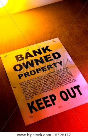 Real Estate Bank Owned Sign On Foreclosed Building In Foreclosure