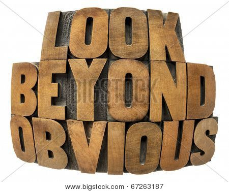 look beyond obvious in wood type - isolated text in fisheye lens perspective in vintage letterpress wood type