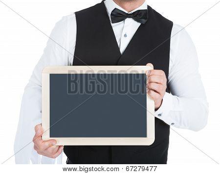 Butler Holding Blank Slate