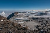 Looking down towards the Western Breach and the icefields of Kilimanjaro poster