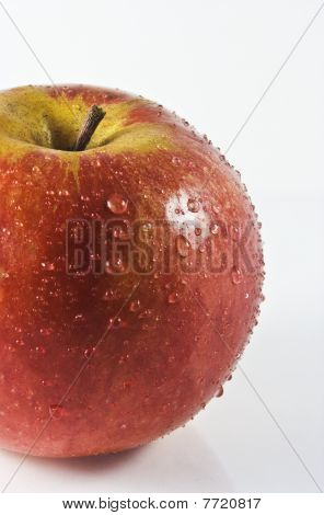 Red Apple With Drops Of Water