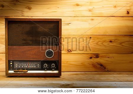Old Retro Radio With Light On Table.