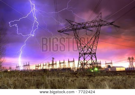Power Distribution Station With Lightning Strike.