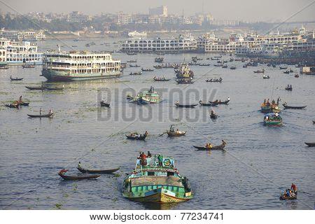 DHAKA BANGLADESH - FEBRUARY 21: Residents of Dhaka cross Buriganga river by boats on February 21 201