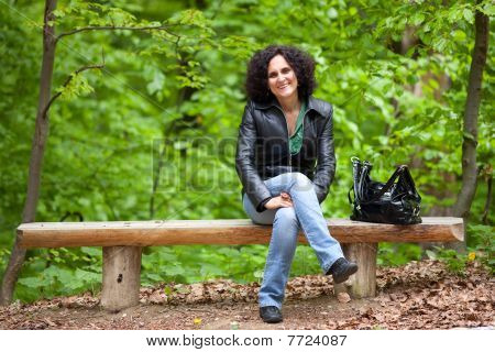Young Lady Sitting On Bench