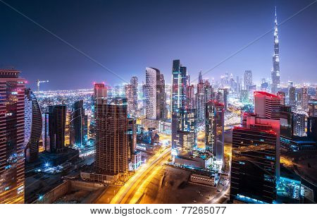 Beautiful night city, cityscape of Dubai, United Arab Emirates, modern futuristic architecture nighttime illumination, luxury traveling concept