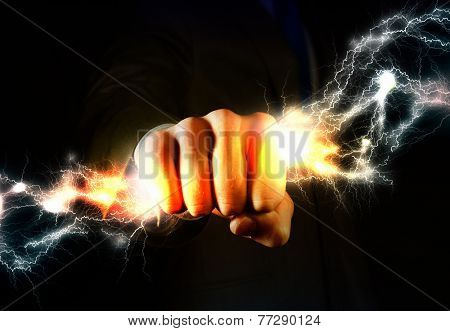 Close up of businessman grasping lightning in hand poster