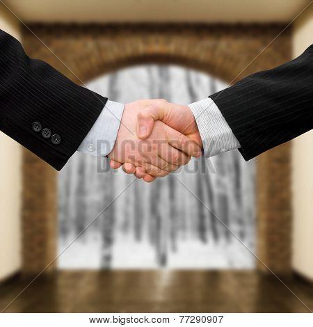 busines man handshake with modern interior background