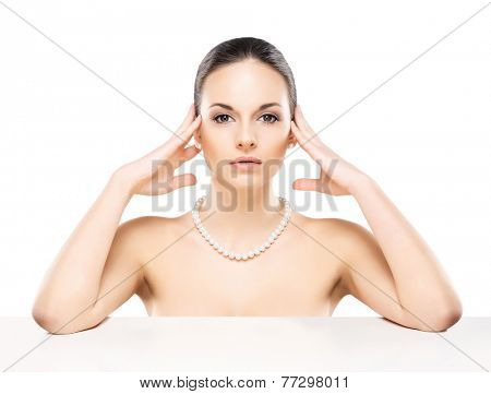 Portrait of young, beautiful and healthy woman in a pearl necklace isolated on white poster