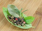 basil's leaf with spices on wooden plank poster