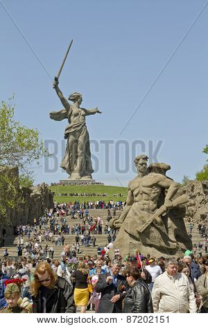 Huge number of people rises up the stairs on the Mamayev Kurgan
