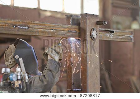 Welder brews metal structure