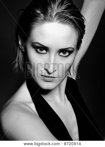 Beautiful Desperate Woman With Perfect Bright Make-up With Red Lips And Dark Shadowed Eyes. Black An