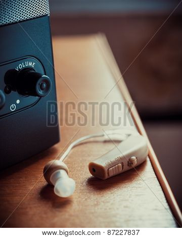 Hearing Aid And Music Speaker On Desk