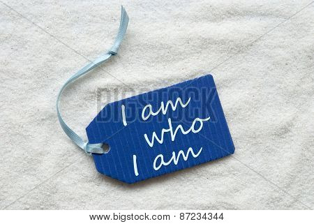 I Am Who I Am On Blue Label Sand Background