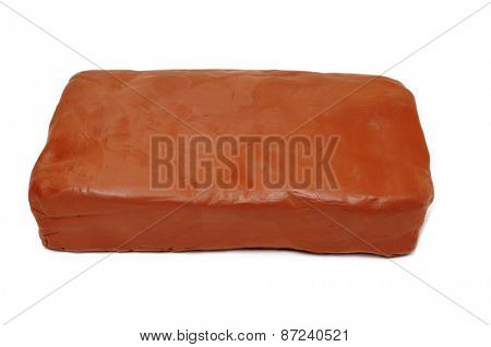 a block of modelling clay on a white background