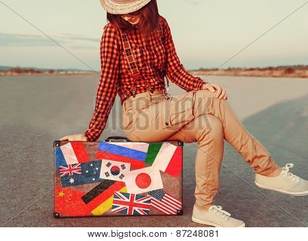 Traveler Sitting On A Suitcase