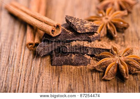 Chocolate Pieces, Star Anise And Cinnamon Sticks Close Up