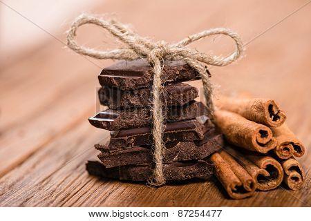Chocolate Pieces And Cinnamon Sticks Close Up