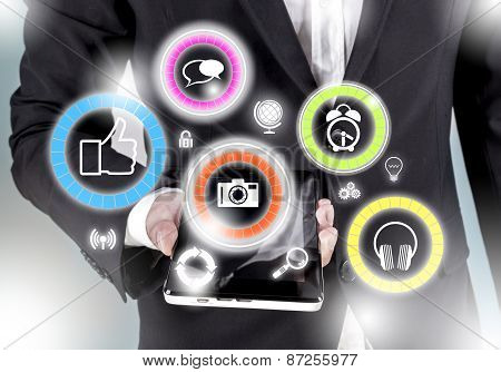 Social Media Icons Coming Out From The Smart Phone Or Tablet In Businessman Hand